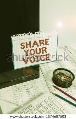Writing note showing Share Your Voice. Business photo showcasing asking employee or member to give his opinion or suggestion Note paper taped to black computer screen near keyboard and stationary.