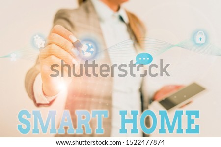 Writing note showing Smart Home. Business photo showcasing automation system control lighting climate entertainment systems Female human wear formal work suit presenting smart device. #1522477874