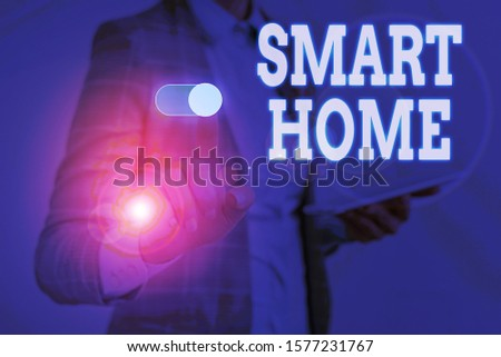 Writing note showing Smart Home. Business photo showcasing automation system control lighting climate entertainment systems Woman wear formal work suit presenting presentation using smart device. #1577231767