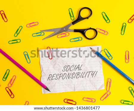 Writing note showing Social Responsibility. Business photo showcasing Obligation for the Benefit of Society Balance in life Crushed striped paper sheet scissors pencils clips colored background.