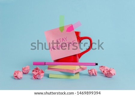 Writing note showing Stay Proactive. Business photo showcasing Taking own decision to go ahead of anticipated events Coffee cup pen note banners stacked pads paper balls pastel background. #1469899394