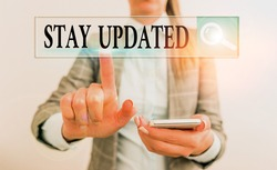 Writing note showing Stay Updated. Business photo showcasing keep modern recent or containing the latest information.