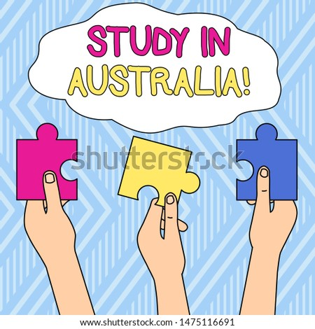 Writing note showing Study In Australia. Business photo showcasing going into foreign country order complete your studies Three Colored Empty Jigsaw Puzzle Pieces Held in Different People Hands.