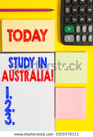 Writing note showing Study In Australia. Business photo showcasing going into foreign country order complete your studies Colored empty papers with copy space on the yellow background table.