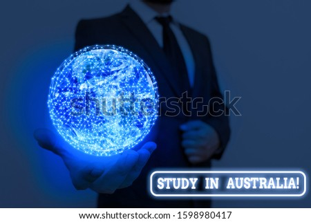 Writing note showing Study In Australia. Business photo showcasing going into foreign country order complete your studies Elements of this image furnished by NASA.