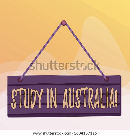 Writing note showing Study In Australia. Business photo showcasing going into foreign country order complete your studies Wood plank nail pin string board colorful background wooden panel fixed.