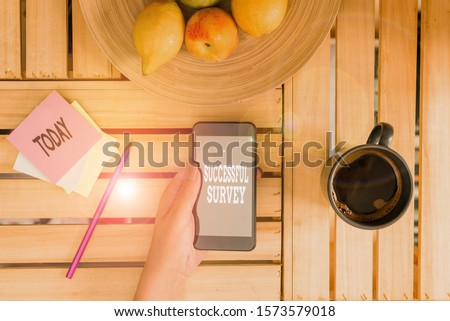 Writing note showing Successful Survey. Business photo showcasing measure of opinions or experiences of a group of showing woman with laptop smartphone and office supplies technology.