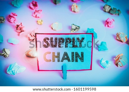 Writing note showing Supply Chain. Business photo showcasing network between a company and suppliers in producing a product Colored crumpled papers empty reminder pink floor background clothespin.