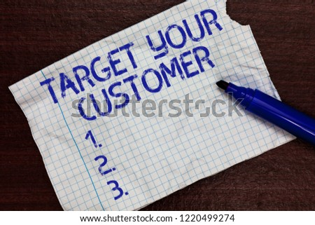 Writing note showing Target Your Customer. Business photo showcasing Tailor Marketing Pitch Defining Potential Consumers Squared notebook paper Markers Communicating ideas Expressing feelings.