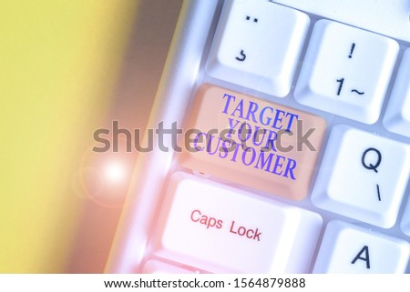 Writing note showing Target Your Customer. Business photo showcasing Tailor Marketing Pitch Defining Potential Consumers White pc keyboard with note paper above the white background.