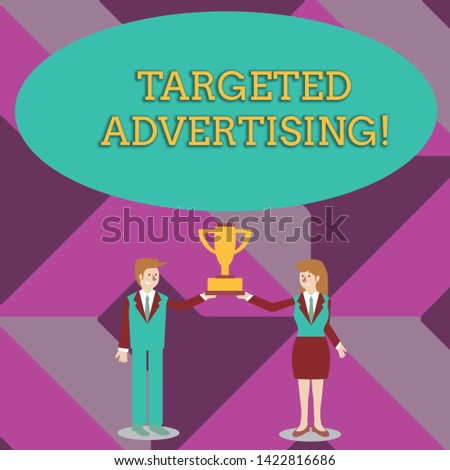 Writing note showing Targeted Advertising. Business photo showcasing Online Advertisement Ads based on consumer activity Man and Woman Business Suit Holding Championship Trophy Cup.