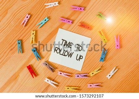 Writing note showing Time To Follow Up. Business photo showcasing Enquiry of the previous task or information Continuation Colored clothespin papers empty reminder wooden floor background office. #1573292107