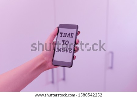 Writing note showing Time To Move. Business photo showcasing Best period to transfer Relocation Change the current path woman using smartphone and technological devices inside the home.