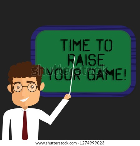 Writing note showing Time To Raise Your Game. Business photo showcasing Be more competitive actions to become the winner Man Standing Holding Stick Pointing to Wall Mounted Blank Color Board.