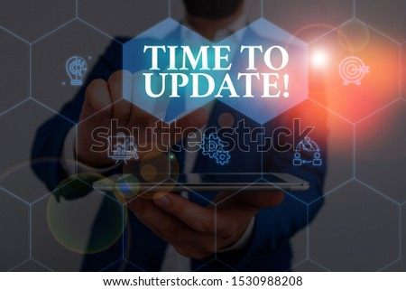 Writing note showing Time To Update. Business photo showcasing act updating something someone or updated version program Male wear formal work suit presenting presentation smart device. #1530988208