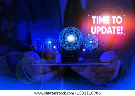 Writing note showing Time To Update. Business photo showcasing act updating something someone or updated version program Male wear formal suit presenting presentation smart device. #1531110986