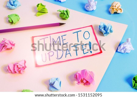 Writing note showing Time To Update. Business photo showcasing act updating something someone or updated version program Colored crumpled papers empty reminder blue yellow clothespin. #1531152095