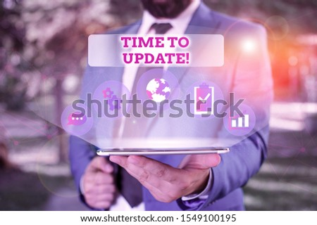 Writing note showing Time To Update. Business photo showcasing act updating something someone or updated version program Male human wear formal suit presenting using smart device. #1549100195
