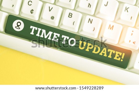 Writing note showing Time To Update. Business photo showcasing act updating something someone or updated version program White pc keyboard with note paper above the white background. #1549228289