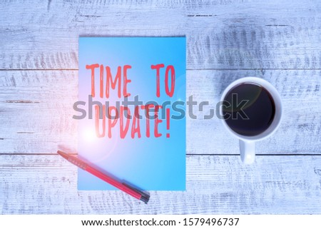 Writing note showing Time To Update. Business photo showcasing act updating something someone or updated version program Stationary placed next to a cup of black coffee above the wooden table. #1579496737
