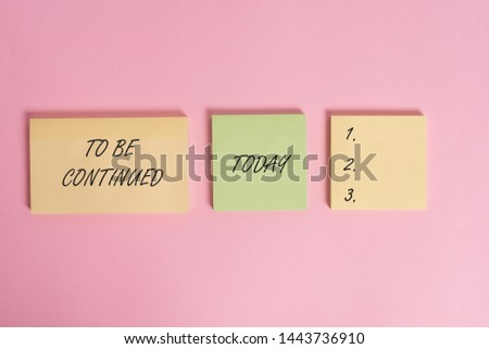Writing note showing To Be Continued. Business photo showcasing indicate that the story continues in the next episode Close up front view three multicolor blank notepads colored background. #1443736910