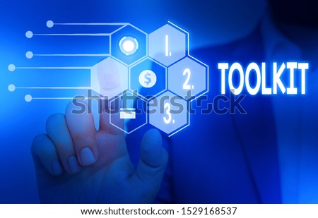 Writing note showing Toolkit. Business photo showcasing set of tools kept in a bag or box and used for a particular purpose Male wear formal suit presenting presentation smart device. #1529168537