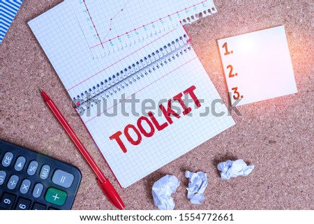 Writing note showing Toolkit. Business photo showcasing set of tools kept in a bag or box and used for a particular purpose Desk notebook paper office paperboard study supplies chart. #1554772661
