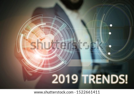 Writing note showing 2019 Trends. Business photo showcasing general direction in which something is developing or changing Male wear formal suit presenting presentation smart device.