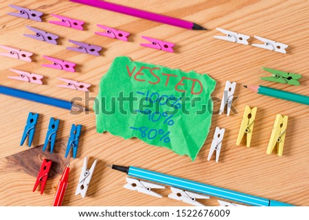 Writing note showing Vested 100 Percent 90 Percent 80 Percent. Business photo showcasing Eligible for Retirement Benefit based on years of Service Colored clothespin papers empty reminder wooden floor