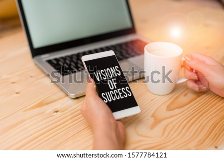 Writing note showing Visions Of Success. Business photo showcasing Clear End Result of Purpose Goal Perspective Plan woman with laptop smartphone and office supplies technology.