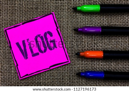 Writing note showing Vlog. Business photo showcasing Entertaining multimedia self broadcasting news reporting stories Marker pens art pink paper nice mat love thought black shadow memories.