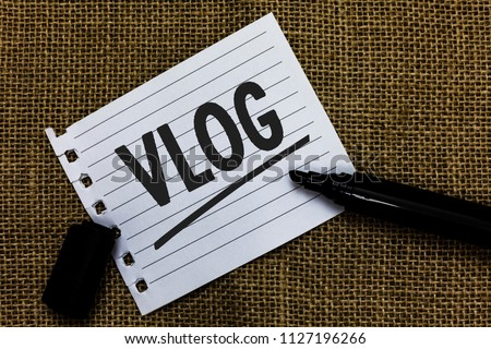 Writing note showing Vlog. Business photo showcasing Entertaining multimedia self broadcasting news reporting stories Ideas paper marker pens important inspiration memories love thoughts.
