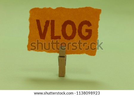 Writing note showing Vlog. Business photo showcasing Entertaining multimedia self broadcasting news reporting stories Nice lime colour grey shadow art work board important clip paperclip.