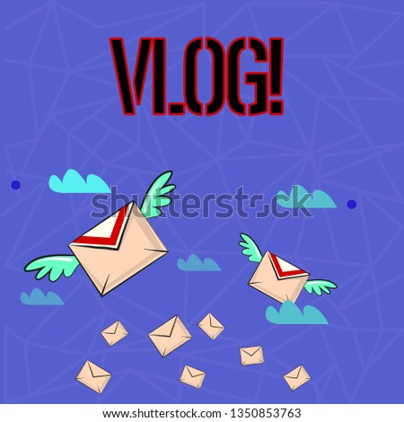 Writing note showing Vlog. Business photo showcasing Entertaining multimedia self broadcasting news reporting stories Colorful Airmail Letter Envelopes and Two of Them with Wings.