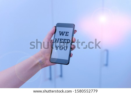 Writing note showing We Need You. Business photo showcasing Company wants to hire Vacancy Looking for talents Job employment woman using smartphone and technological devices inside the home.