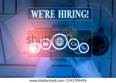 Writing note showing We Re Hiring. Business photo showcasing recently employ someone or pay him to do particular job Picture photo network scheme with modern smart device.