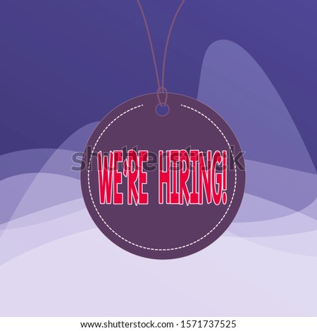 Writing note showing We Re Hiring. Business photo showcasing recently employ someone or pay him to do particular job Label string round empty tag colorful background small shape.