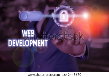 Writing note showing Web Development. Business photo showcasing dealing with developing websites for hosting via intranet.