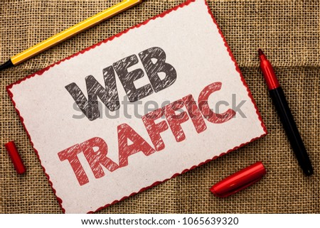 Writing note showing  Web Traffic. Business photo showcasing Internet Boost Visitors Audience Visits Customers Viewers written on Cardboard Piece on the jute background Markers next to it. #1065639320