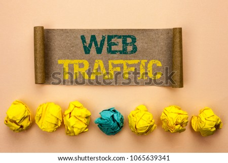 Writing note showing  Web Traffic. Business photo showcasing Internet Boost Visitors Audience Visits Customers Viewers written on Cardboard Paper on the plain background Crumpled Paper Balls #1065639341