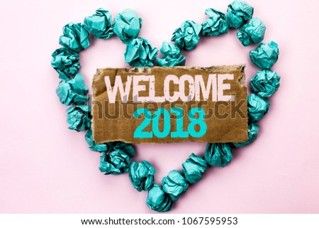 Writing note showing  Welcome 2018. Business photo showcasing Celebration New Celebrate Future Wishes Gratifying Wish written on Tear Cardboard on Plain background on Heart Paper Balls. #1067595953