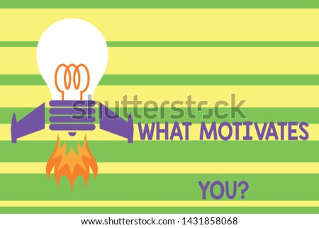 Writing note showing What Motivates Youquestion. Business photo showcasing know reasons why you want to wake up each morning Top view launching bulb rocket fire base Project Fuel idea.