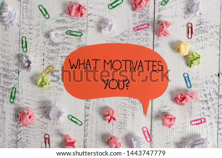 Writing note showing What Motivates Youquestion. Business photo showcasing know reasons why you want to wake up each morning Blank speech bubble paper balls clips wooden vintage rustic background.