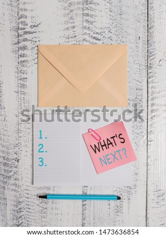 Writing note showing What S Next Question. Business photo showcasing asking demonstrating about his coming actions or behaviors Envelop squared notepad note clip marker old wooden vintage background. #1473636854