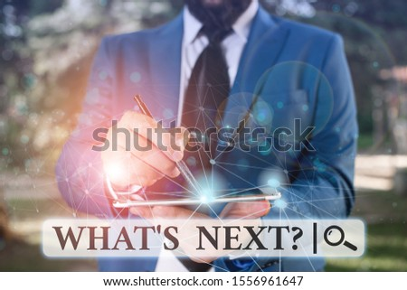Writing note showing What S Next Question. Business photo showcasing asking demonstrating about his coming actions or behaviors Male human wear formal suit presenting using smart device. #1556961647