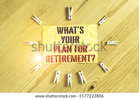 Writing note showing What S Your Plan For Retirement Question. Business photo showcasing Savings Pension Elderly retire Colored clothespin papers empty reminder wooden floor background office.