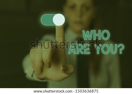 Writing note showing Who Are You Question. Business photo showcasing asking about its identity or demonstratingal information Woman wear formal work suit presenting presentation using smart device.