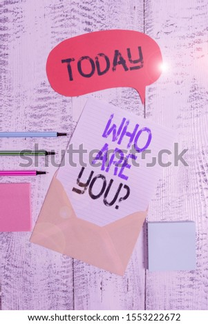Writing note showing Who Are You Question. Business photo showcasing Identify yourself description demonstratingal characteristics Envelop speech bubble paper sheet ballpoints notepads wooden