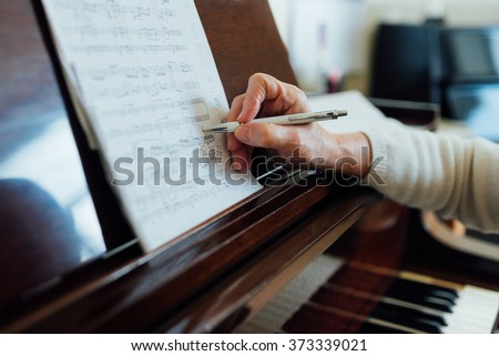 writing notes on sheet music close-up #373339021