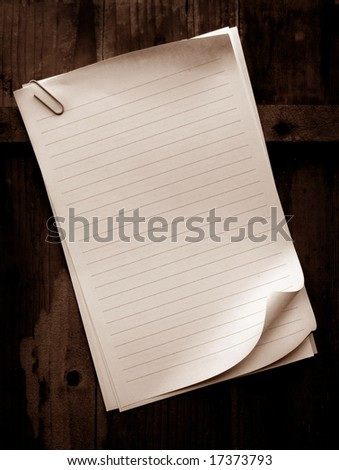 Writing old note paper on wood background